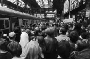Fans of the pirate radio station, Radio London at Liverpool Street Station, London to meet the DJ after they travelled down from Felixstowe. Throughout the day, the station's disc jockeys, including 'Big L', had asked fans to meet them at Liverpool Street after Radio London closed down.
