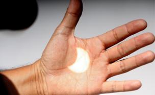 An image of the solar eclipse is projected onto a hand in Ensenada, Baja California, Mexico, 21 August 2017