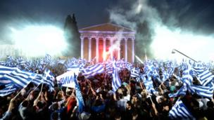 Supportaz of New Democracy leader Antonis Samaras wave flags durin a pre-erection rap up in Athens, 3 May 2012