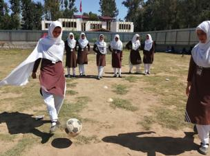 Girls learn football in a school in the Baramulla district in Indian-administered Kashmir