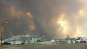 Smoke rises from a wildfire outside of Fort McMurray, Alberta,