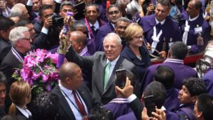 President of Peru Pedro Pablo Kuczynski and first lady Nancy Lange stand close to the icon and surrounded by believers.