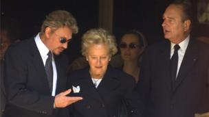 A file photo taken on June 25, 1999 in Paris shows French president Jacques Chirac (R), his wife Bernadette and French singer Johnny Hallyday
