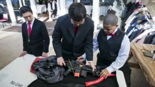 Parishioners with the Sanctuary Church inspect an AR-15
