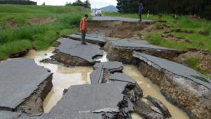 An engineer inspects a ruptured road near Waiau