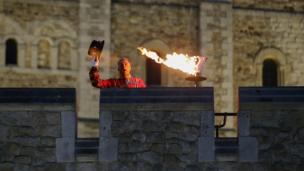 The Chief Yeoman Warder at the Tower of London lit a beacon to celebrate Queen's birthday.