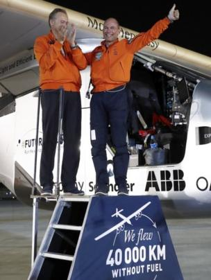 Solar Impulse 2 pilots Andre Borschberg (left) and Bertrand Piccard celebrate in Abu Dhabi. Photo: 26 July 2016