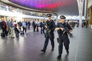 Armed police officers patrol at King's Cross station in London on Wednesday, after the Manchester Arena bombing.