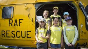 Cardiff brownies pose for a picture at the RAF Wessex helicopter which was one of the aircraft on display.