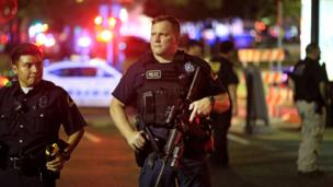Armed police officers on a street in Dallas, Texas - July 2016
