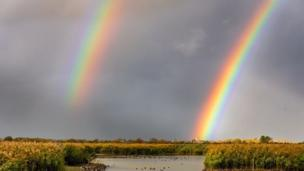 A huge, bright double rainbow in line with Charlton-on-Otmoor Church