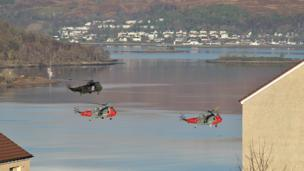 Royal Navy Sea King helicopters fly over Fort William
