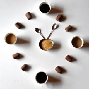 Clock made of coffee cups and rolls