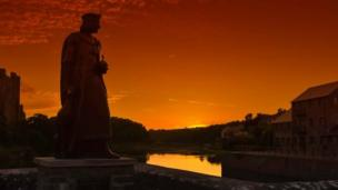 Henry VII statue overlooking Pembroke at sundown