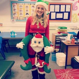 Alison Gray wearing Santa-piggyback fancy dress