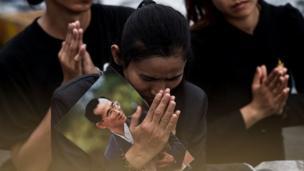 Woman mourning in Bangkok