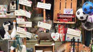 A shop front in Usk with lots of love signs