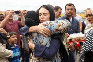 New Zealand Prime Minister Jacinda Ardern hugs a woman at the Kilbirnie Mosque, in Wellington, following mass shooting attacks in Christchurch. Fifty people died on 15 March when a white supremacist attacked two mosques while livestreaming on Facebook.