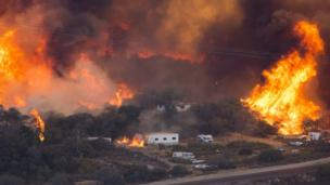 Fires rage near a highway in California in December 2017.