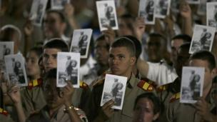Military cadets hold pictures of Fidel Castro during a rally at the Revolution Plaza in Havana, Cuba, Tuesday, Nov. 29, 2016.