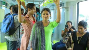 Transgender employees inside one of the new coaches of the Cochin metro