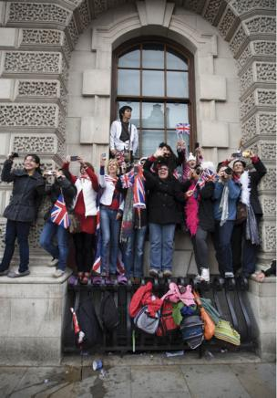 A crowd of onlookers in Whitehall, London