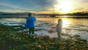 Children play by Loch Etive