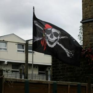 Skull and crossbones flag in Dalston, London