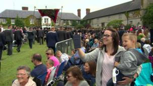 Royal Black parade and crowds with woman and child taking a selfie, Scrava, Craigavon, 13 July 2017
