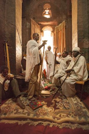 Gathering for prayer, song and Bible study in a monolithic rock-hewn church at Lalibela