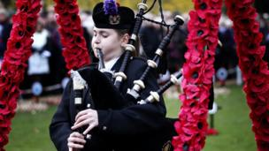 A piper plays during the two-minute silence in Edinburgh