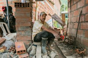 A man sits at a building site in Santa Lucia in July 2016.