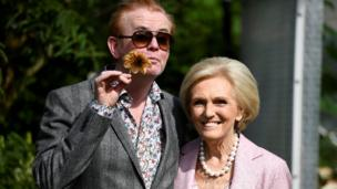 Television presenters Chris Evans and Mary Berry pose for pictures