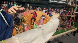 A sleeping Gulliver is led through the streets of Armagh