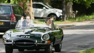 Pippa Middleton and James Matthews wave as they drive a Jaguar E-Type after their wedding