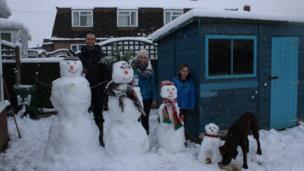 The Jones family with their snowmen