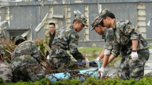 """Chinese paramilitary policemen work near damaged factory buildings in Funing county in Yancheng city in eastern China""""s Jiangsu Province Friday, June 24, 2016."""