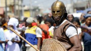 A man dressed up as a soldier takes part in a re-enactment of the crucifixion of Jesus Christ on Good Friday in Lagos, Nigeria 25 March 2016