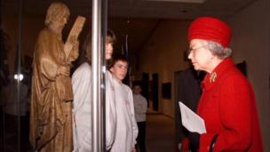The Queen views an exhibit, during the opening of the New Museum of Scotland, in Edinburgh in 1998