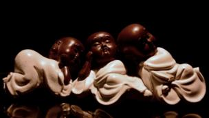 Three monks sleep in this sculpture