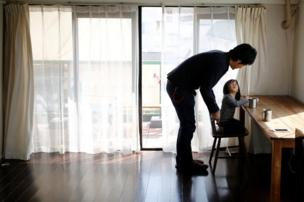 Minimalist Naoki Numahata talks to his two-and-a-half year old daughter Ei in their living-room in Tokyo