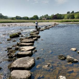 Crossing stones on a river