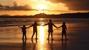 Sunset beach: Alexandra Nash's spectacular view of children holding hands at Black Rock Sands, Gwynedd