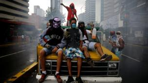 Demonstrators ride on a truck while rallying against Venezuelan President Nicolas Maduro's government in Caracas, June 29, 2017
