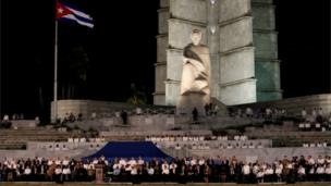 The Cuban flag flies at half-mast as dignitaries gather for a massive tribute to Cuba's late President Fidel Castro in Revolution Square in Havana, Cuba, November 29, 2016.