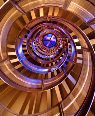 A view looking up at a large spiral staircase