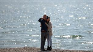 Couple take selfie on Southsea beach, Portsmouth