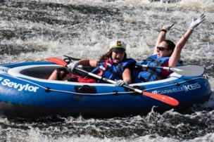 Two women in a dingy