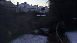 Snow covered garden and rooftops in Southend-on-sea