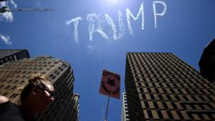 "A view of the skywriting word reading ""Trump"" as thousands rally in support of equal rights in Sydney, New South Wales, Australia, 21 January 2017"